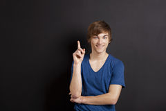 Young man over a chalk board Stock Image