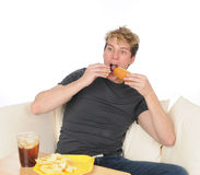 Young man overeating Stock Photography