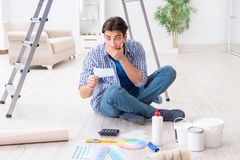 The young man overspending his budget in refurbishment project Stock Photo