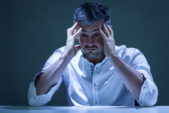 Young man overwhelmed by problems. Portrait of young man overwhelmed by problems Royalty Free Stock Photos