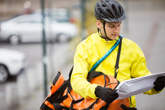 Young Man With Package And Courier Bag On Street Royalty Free Stock Images