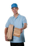 Young man from package courier service takes Stock Photos