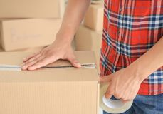 Young man packing box Stock Image