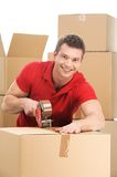 Young man packing boxes to move in new flat. Royalty Free Stock Images