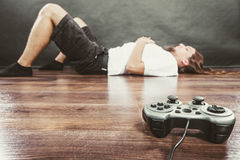 Young man with pad. Addiction and dependency concept. Young man with pad joystick playing games. Male addicted to console playstation videogames Royalty Free Stock Photography