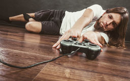 Young man with pad. Addiction and dependency concept. Young man with pad joystick playing games. Male addicted to console playstation videogames Stock Photo