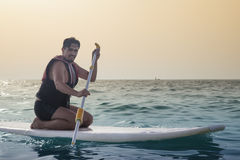 Young Man Paddleboarding Stock Image