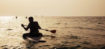Young Man Paddleboarding Stock Photos