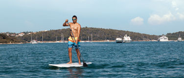 Young Man Paddleboarding Royalty Free Stock Images