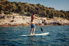 Young Man Paddleboarding Royalty Free Stock Photo