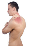 Young man and a pain in the neck. Naked man holding hand on her neck. Pain and tension Royalty Free Stock Images