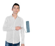 Young man with paint brush Royalty Free Stock Images