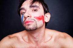 Young man with paint on his face Royalty Free Stock Image