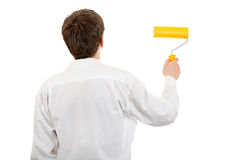 Young Man with Paint Roller Royalty Free Stock Photos