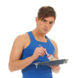 Young man painter and brush Stock Image