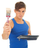 Young man painter and brush Royalty Free Stock Images