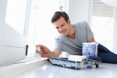 Young man painting home Stock Photos