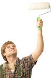 Young man painting with roller Royalty Free Stock Photo