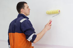 Young man with painting roller for walls Stock Photography