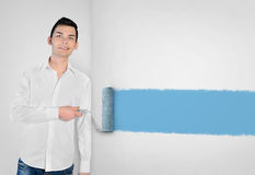 Young man painting on wall Stock Photo
