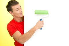 Young man painting white wall. Stock Photos