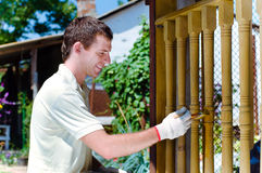Young Man Painting Wooden Fence Stock Photos