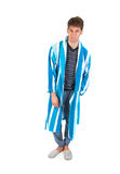 Young man in pajamas and gown Stock Image