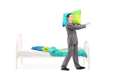 Young man in pajamas sleepwalking Royalty Free Stock Photography