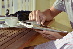 Young man in pajamas using a tablet Stock Image