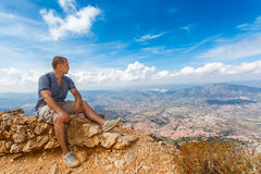 Young man and panoramic view from the mountains Royalty Free Stock Image