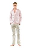 Young man in pants and shirt. Isolated on white Stock Image