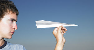 Young Man with Paper Airplane Royalty Free Stock Photos