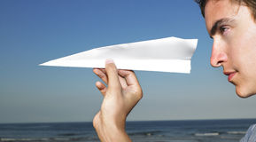 Young Man with Paper Airplane Stock Photo