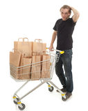 Young man with paper bags Royalty Free Stock Image