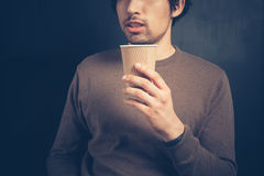Young man with a paper cup Stock Images