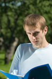 Young man with papers Royalty Free Stock Photos