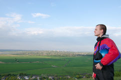 Young man parachutist preparing for flying. With serious look Royalty Free Stock Image