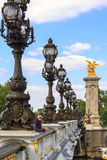 A young man in Paris on the bridge of Alexander III, France Stock Images