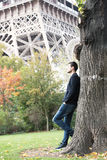 Young man in Paris. France, in front of Eiffel Tower Stock Image