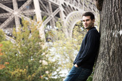 Young man in Paris. France, in front of Eiffel Tower Stock Photo