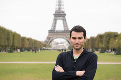 Young man in Paris. Young man standing in front of Eiffel Tower in Paris, France, wearing black clothes Royalty Free Stock Photography