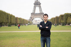 Young man in Paris. Young man standing in front of Eiffel Tower in Paris, France, wearing black clothes Stock Photography