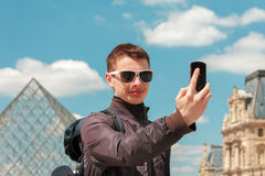 A young man in Paris take a selfie Royalty Free Stock Image