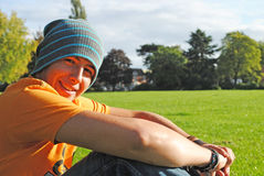 Young man at the park. A young man sitting at the park and enjoying nature Royalty Free Stock Photos