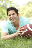 Young Man In Park With American Footba Stock Photography