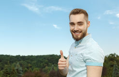 Young man in the park. Royalty Free Stock Image