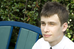 Young man on park bench Stock Photo