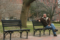 Young man on park bench. Young man sitting on park bench near White House stock photography