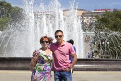 The young man in the park with her mother Stock Images