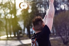 A young man in the park performs tricks with Diabolo stock photo
